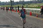 Chris crossing the finish line